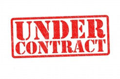 19411860-UNDER-CONTRACT-Rubber-Stamp-over-a-white-background--Stock-Photo